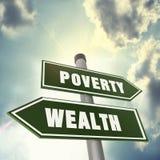 Riktning av rikedom eller armod Arkivfoton