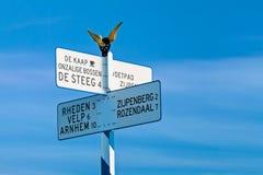 Riktningstecken överst av den berömda holländaren Posbank Royaltyfri Fotografi