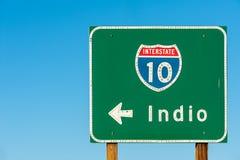 Riktningstecken till Indio arkivfoto