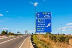 Riktningstecken till Madrid Barcelona och Valencia Spain Royaltyfri Foto