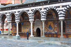 Rila Monastery, Bulgaria church entrance. Rila, Bulgaria - October 27, 2017: Rila monastery church entrance and people Stock Images