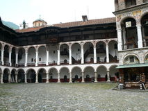 Rila Monastery in the mountains. Columns and architecture. Touristic place Stock Photography