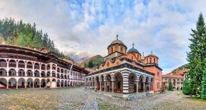 Rila monastery panorama with clouds Stock Photos