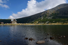 Rila mountain lake. Rila mountain landscape with blue sky and clouds Royalty Free Stock Images