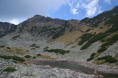 Rila mountain lake. Rila mountain landscape with blue sky and clouds Stock Photo