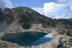 Rila mountain lake. Rila mountain landscape with blue sky, clouds and a lake Royalty Free Stock Images