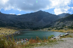 Rila mountain. Landscape with blue sky and clouds and a lake Stock Image