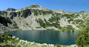 Rila mountains in Bulgaria, deep blue lakes and gray rock summit during the sunny day with clear blue sky Royalty Free Stock Photography