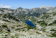 Rila mountains in Bulgaria, deep blue lakes and gray rock summit during the sunny day with clear blue sky Royalty Free Stock Images