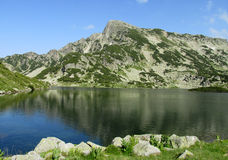 Rila mountains in Bulgaria, deep blue lakes and gray rock summit during the sunny day with clear blue sky Stock Photo