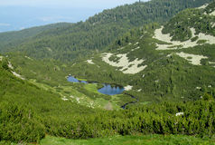 Rila mountains in Bulgaria, deep blue lakes and gray rock summit during the sunny day with clear blue sky Stock Photography