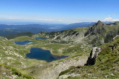 Rila mountains in Bulgaria, deep blue lakes and gray rock summit during the sunny day with clear blue sky Royalty Free Stock Image