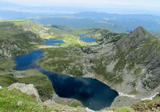 Rila mountains in Bulgaria, deep blue lakes and gray rock summit during the sunny day with clear blue sky Royalty Free Stock Photos