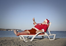 Rilassi alla spiaggia Fotografie Stock Libere da Diritti