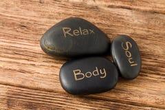 Rilassi, anima, pietre della lava del corpo tre Immagine Stock
