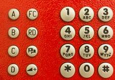 Rilievo rosso della manopola del telefono pubblico Fotografie Stock