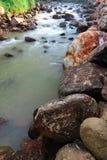 Rill e pedra no começo de chuvoso fotografia de stock