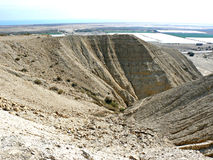 Rill erosion - desert hills. Rills on the steep hill slopes, formed by erosion of rainwater in the desert landscape in Qumran, Israel stock images