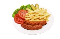 Rilled and sliced fresh pork sausage, Royalty Free Stock Photos