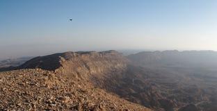 Rim of desert canyon at sunset Stock Photo