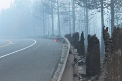 The Rim Fire In Yosemite ~ 2013 ~ Burnt Road Railing. Photo of The Rim Fire In Yosemite ~ 2013 ~ Burnt Road Railing. The Rim Fire in Yosemite National Park royalty free stock photos