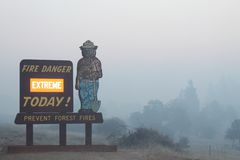 The Rim Fire In Yosemite ~ 2013 ~ Smoke Behind Fire Sign. Photo of The Rim Fire In Yosemite ~ 2013 ~ Smoke Behind Fire Sign. The Rim Fire in Yosemite National Royalty Free Stock Photo