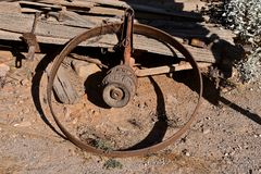 Rim and hub of an old wooden wagon. An old wooden wagon with a hub on the axle, a steel band for the wheel, but lacking the spokes Royalty Free Stock Photography