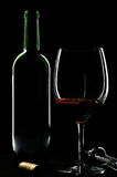 Rim Lit wine glass and bottle royalty free stock photo