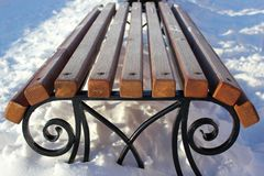 Rime on the bench in the winter. A bench in the snow. Royalty Free Stock Photo