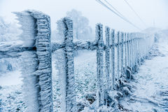 Rime covered fence by the skilift Royalty Free Stock Images