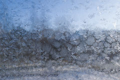 Rime and patterns of the snowflakes. On the glass for background Royalty Free Stock Image