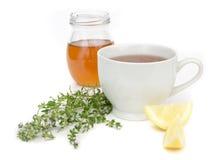 Rimedio freddo con il miele ed il limone del tè Fotografie Stock