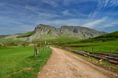 Rimetea village and Piatra Secuiului at spring. Royalty Free Stock Photography