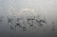 Rimfrost på ett fönster Arkivfoton