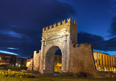 Rimini, the arch of Augustus. Night view of Augustus arch in Rimini - ancient romanesque gate of the city - historical landmark of Italy, the most ancient roman Stock Photos