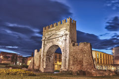 Rimini, the arch of Augustus - HDR. Night view of Augustus arch in Rimini - ancient romanesque gate of the city - historical landmark of Italy, the most ancient Stock Photos