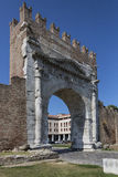 Rimini - Arch of Augustus - Italy. The Roman Arch of Augustus, built in 27 BC. Merlons crenellation were added to the top in the Middle Ages. It was restored in Stock Photography
