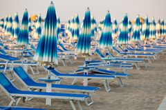 Free Rimini Beach With Blue Sun Umbrellas. Stock Photos - 139404853