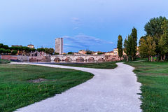 Rimini city park. Sunset time. Evening on tiberius bridge Royalty Free Stock Photo