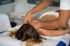 Rimini, Italy - june 2017: Athlete`s Back Massage after Fitness Activity: Wellness and Sport Royalty Free Stock Photos