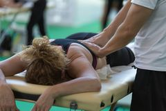 Rimini, Italy - june 2017: Athlete`s Back Massage after Fitness Activity: Wellness and Sport Royalty Free Stock Photography