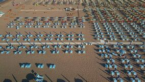 The hundreds of beach chairs on the coast of Rimini