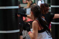 Rimini, Italy - may 2016:Young Girl with Shorts and White Tank Top: Fitness Boxing Workout with Punching Bag.  Stock Image