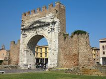 13.06.2017, Rimini, Italy - tourists near Arch of Augustus, anci. Ent romanesque gate of the city - historical italian landmark Stock Photo