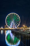RIMINI night view of ferris wheel from dock Stock Image