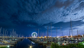 RIMINI, night view of marina with ferris wheel. Night view of marina with ferris wheel in background. Rimini. Italy stock image