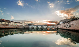 Rimini sunset on Tiberius bridge. Twilight. Stock Photo
