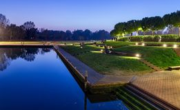 Rimini sunset view of city park with evening lights. Modern and ancient architecture