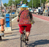 Rimini- A woman cyclist stock photo
