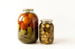 Rimmade tomater och gurkor Arkivfoto